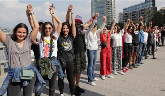 Lebanese people form nationwide human chain in solidarity with protests