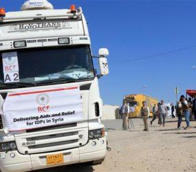 Iraqi trucks loaded with humanitarian aid head to Syria