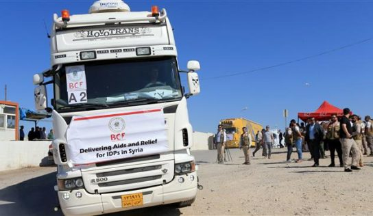 Iraqi trucks loaded with humanitarian aid head to Syria