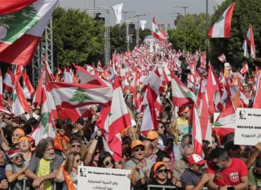 Thousands of Lebanese rally in support of President Aoun amid anti-government protests