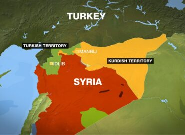 Is Turkey  conducting direct talks with Syria?